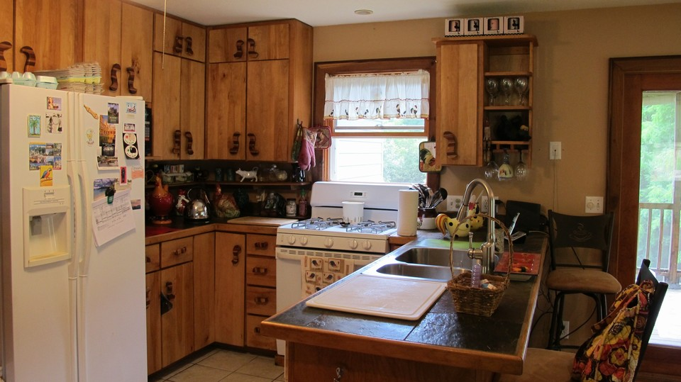 open-layout, cabinets hewn from property